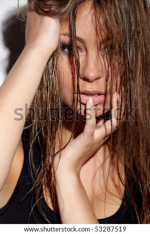 Closeup portrait of young glamorous woman with wet hair - stock photo