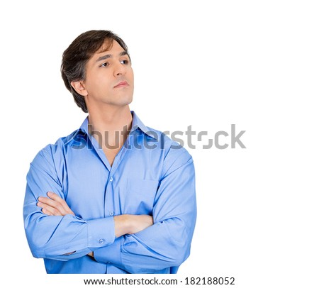Closeup portrait of young grumpy man arms crossed, bad attitude, does not want to listen to your explanation, isolated white background. Negative emotions, facial expression feelings, body language - stock photo