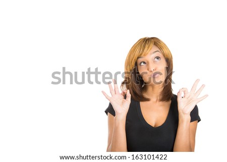 Closeup portrait of young  happy, smiling excited beautiful woman giving OK sign with fingers, isolated on white background with copy space to left. Positive emotion facial expressions and symbols - stock photo