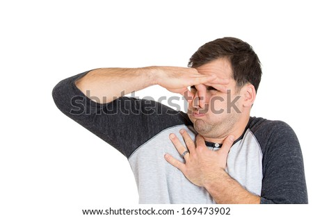 Closeup portrait of young man, disgust on his face, pinches his nose looks away, something stinks, very bad smell, situation, isolated on white background. Negative emotion facial expression feeling - stock photo