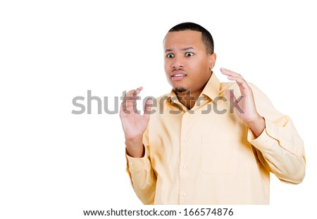 Closeup portrait of young man, looking shocked, scared trying to protect himself in anticipation of an unpleasant situation, isolated on a white background. Negative emotion facial expression feeling