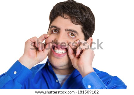 Closeup portrait of young man making scary, funny, weird faces with hands, isolated on white background. Negative human emotion facial expression feelings, attitude,reaction, perception. - stock photo
