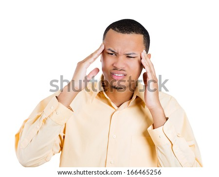 Closeup portrait of young man thinking daydreaming deeply about something hands on temple with headache looking away, isolated on white background. Negative emotion facial expression feeling - stock photo