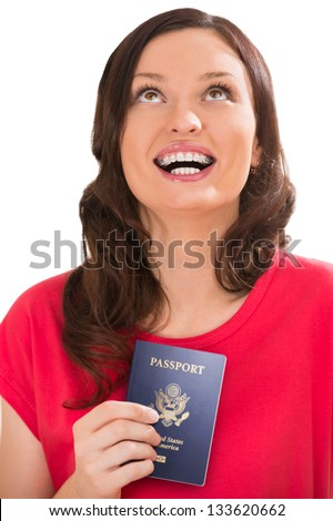 Closeup portrait of young positive woman holding passport and dreaming - stock photo