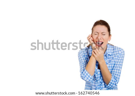 Closeup portrait of young, sad, crying, troubled, desperate pretty woman, student, wife, girlfriend, worker, corporate employee, isolated on a white background. Human emotions and facial expressions. - stock photo
