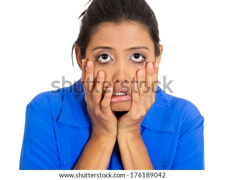 Closeup portrait of young shocked, horrified, pretty woman worried and stressed with hands on face dragging face down, isolated on white background. Negative emotion facial expression feelings - stock photo