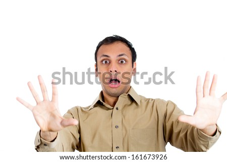 Closeup portrait of young shocked, terrified horrified man gesturing stop with palms hands and open mouth, isolate on white background. Negative human emotion facial expressions - stock photo
