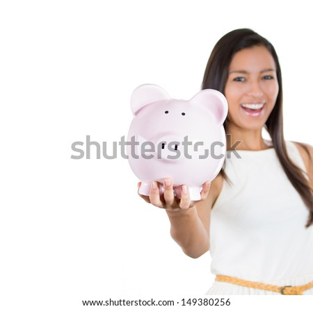 Closeup portrait of young smiling school student, worker woman holding piggy bank, isolated on white background. Smart currency financial investment wealth decisions. Budget management and savings - stock photo