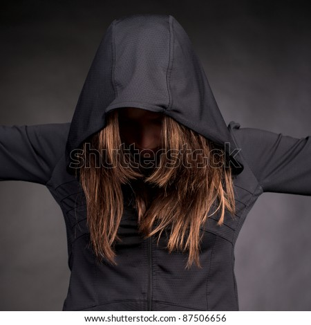 Closeup portrait of young woman in hood with hidden face - stock photo