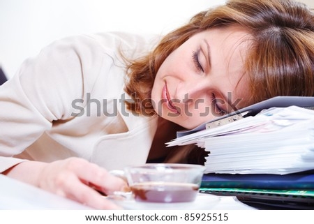 Closeup portrait of young woman in suit, sleeping on the documents stack
