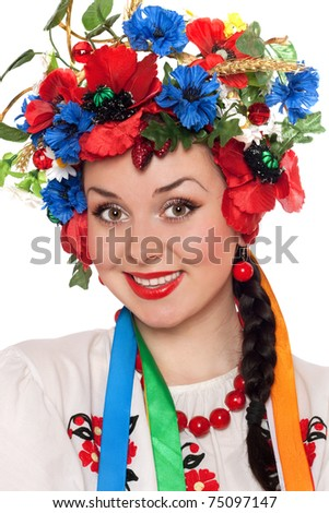 Closeup portrait of young woman in the Ukrainian national clothes - stock photo