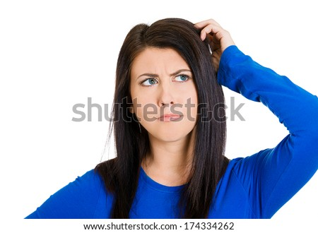 Closeup portrait of young woman scratching head, thinking daydreaming deeply about something, looking up, isolated on white background. Human facial expressions, emotions, feelings, signs, symbols - stock photo