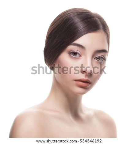 closeup portrait of young woman with clean fresh skin isolated on white background.