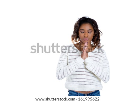 Closeup portrait of young woman with closed eyes praying hoping for the best asking for forgiveness or miracle isolated on white background with copy space. Positive human emotions facial expressions