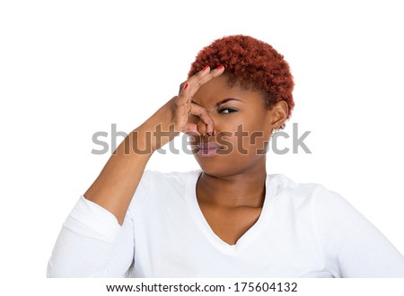 Closeup portrait of young woman with disgust on her face, covers pinches nose looks at you, something stinks, very bad smell, situation, isolated on white background. Human emotions, face expressions. - stock photo