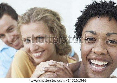 Closeup portrait of young woman with friends having fun together - stock photo