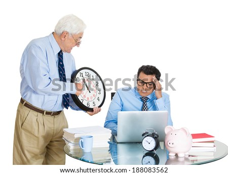 Closeup portrait, old business man boss, checking on young employee, pointing to clock, pushing to work hard on project, who is unhappy, isolated white background. Conflict at work place - stock photo