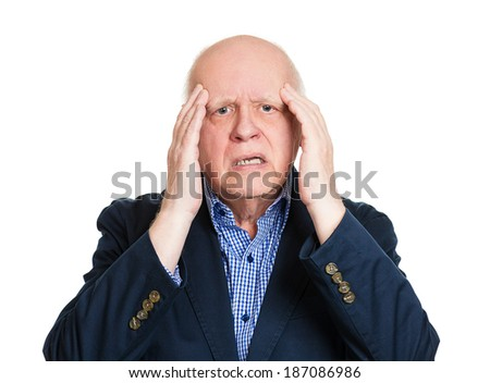 Closeup portrait old stressed man, grandfather, overwhelmed corporate executive, hands on temples, having headache isolated white background. Conflict situation. Face expression emotion reaction