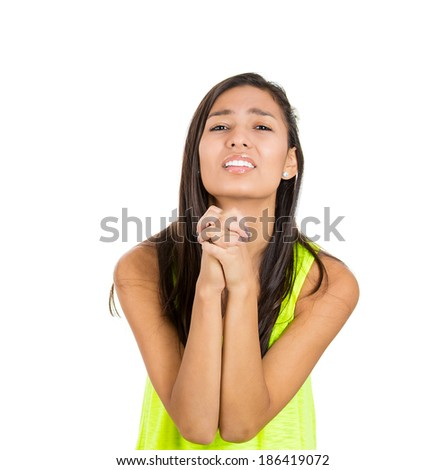 Closeup portrait, pretty young woman gesturing with clasped, pretty please with sugar on top, isolated white background. Positive emotion facial expression feelings, signs symbols, body language. - stock photo