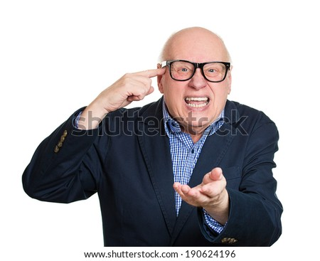 Closeup portrait, rude angry, senior business man gesturing with finger against temple, are you crazy? Isolated white background. Negative human emotion, facial expression, feeling, attitude, reaction - stock photo