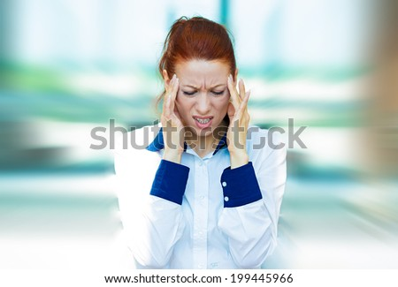 Closeup portrait sad unhappy young business woman, hands on head, bothered by mistake having bad headache isolated background corporate office. Negative human emotion, facial expression life reaction - stock photo