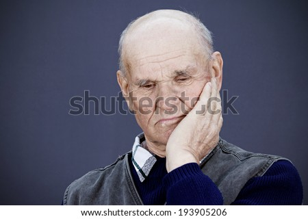 Closeup portrait senior, elderly, mature, sad depressed man, deep in thought, thinking, realizing truth, looking down isolated black background. Human face expressions, emotions, feeling, reaction - stock photo