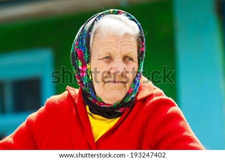 Closeup portrait senior, elderly woman with grey hair on porch of her house, thoughtful, looking away as if she is waiting for someone. Human emotions, facial expressions, life perception, reaction - stock photo