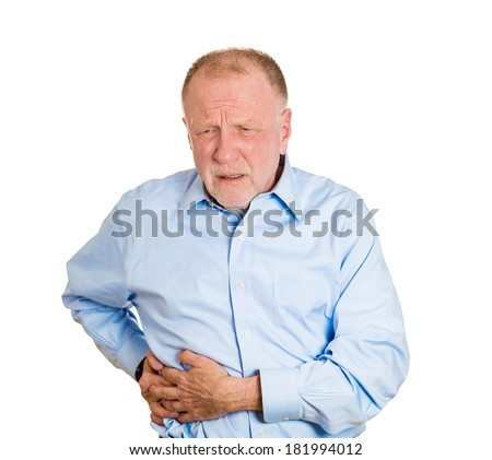 Closeup portrait senior executive old man, elderly corporate employee grandfather looking miserable, doubling over in stomach, spleen pain, isolated white background. Nephrolithiasis. face expression - stock photo