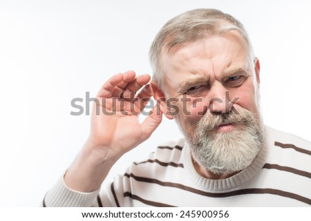 Closeup portrait, senior man, grandfather hard of hearing, placing hand on ear asking someone to speak up, isolated white background. Negative emotion, facial expressions, feelings, reaction, aging - stock photo