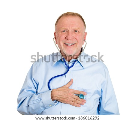 Closeup portrait, senior mature business man, male employee, worker listening to his heart with stethoscope isolated white background. Preventive medicine financial condition check-up concept - stock photo