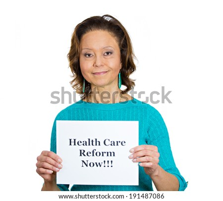 Closeup portrait senior mature business woman, elderly lady, employee holding health care reform now! sign, isolated white background. Government, federal politics, congress, insurance policy debate - stock photo