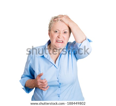 Closeup portrait, senior mature business woman looking shocked, surprised, disgusted disbelief, hand on head, isolated white background. Negative human emotions, facial expressions, feelings, reaction - stock photo
