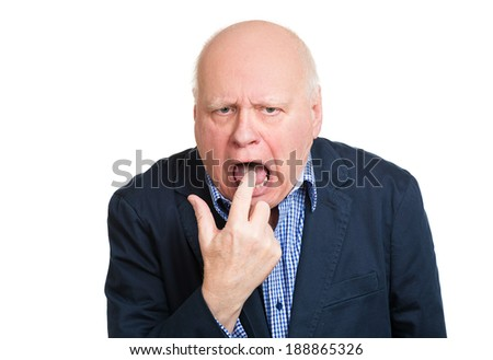 Closeup portrait, senior mature unhappy, annoyed, sick business man putting finger in mouth showing something sucks, isolated white background. Negative human emotion, feeling, facial expression, sign - stock photo