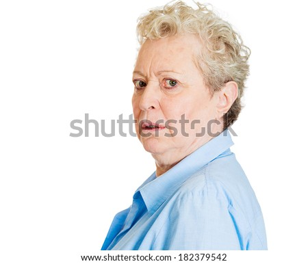 Closeup portrait senior woman, grandmother, looking surprised, shocked, scared looking behind her shoulder, feels being followed, isolated white background. Conflict situation. Emotions, expressions - stock photo