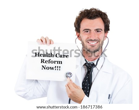 Closeup portrait, serious, confident male health care professional,doctor, physician, dr or md with stethoscope listening to the sign that says healthcare reform now???, isolated white background. - stock photo