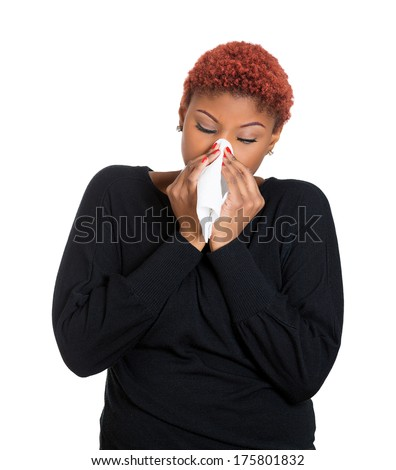 Closeup portrait sick young woman student, worker, employee with allergy, germs cold, blowing nose with kleenex, looking miserable unwell very sick, isolated on white background. Flu season, vaccine - stock photo