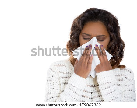 Closeup portrait sick young woman student, worker, employee with allergy, germs, cold, blowing nose with kleenex, looking miserable, unwell very sick, isolated on white background. Flu season, vaccine - stock photo