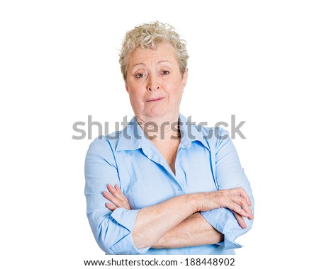 Closeup portrait, skeptical, senior mature woman looking suspicious, disgust and disapproval on face, arms crossed folded, isolated white background. Negative human emotion, facial expression, feeling - stock photo