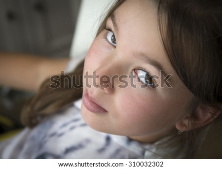 Closeup portrait skeptical young little girl looking suspicious - stock photo