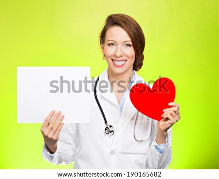 Closeup portrait smiling, cheerful health care professional, pharmacist, dentist, nurse, cardiologist doctor with stethoscope, holding heart, blank white paper, copy space, isolated green background. - stock photo