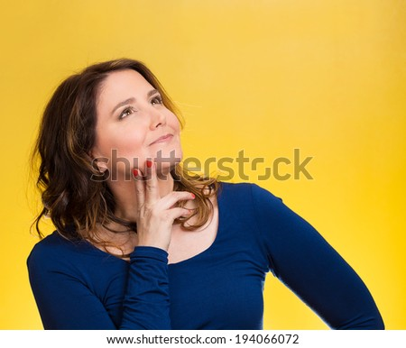 Closeup portrait smiling, joyful, happy, middle aged woman looking upwards daydreaming, thinking isolated yellow background. Positive emotions, facial expressions, feelings, life perception, attitude - stock photo
