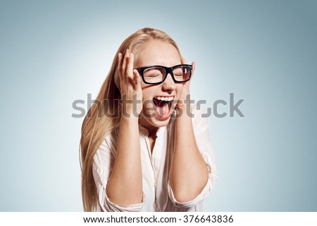 Closeup portrait stressed, frustrated shocked business woman pulling hair out yelling screaming temper tantrum isolated wall background. Negative human emotion facial expression reaction attitude - stock photo