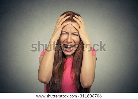 Closeup portrait stressed frustrated woman yelling screaming having temper tantrum isolated on gray wall background. Negative human emotion facial expression reaction attitude - stock photo