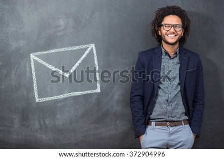 Closeup portrait stunned, surprised businessman in black glasses . electronic device and internet concept. - stock photo