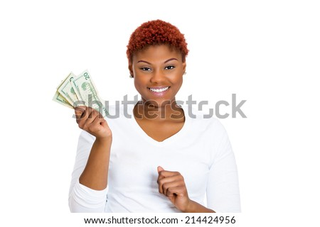 Closeup portrait super happy excited successful young business woman holding money dollar bills in hand, isolated white background. Positive human emotions, facial expression feeling. Financial reward - stock photo