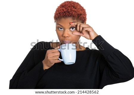 Closeup portrait tired, falling asleep young woman, student holding cup coffee struggling not to crash stay awake, keeping eyes opened, isolated white background. Human face expression, body language - stock photo