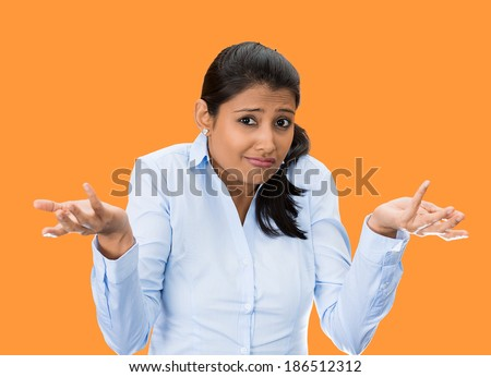 Closeup portrait, unhappy, young, pretty business woman, manager, student, worker asking whats the problem, who cares, so what, I dont know. Isolated orange background. Negative human emotions - stock photo