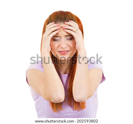 Closeup portrait unhappy young woman, head on hand standing, bothered by mistakes, having bad headache isolated white background. Negative human emotion, facial expression, feeling reaction perception - stock photo