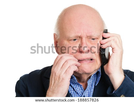Closeup portrait upset, sad, depressed, worried senior man, old employee, father, worker talking on phone, isolated white background. Human face expression emotion, feeling, reactions, life perception