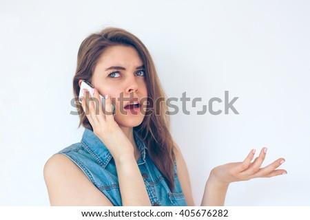 Closeup portrait upset, unhappy, serious woman talking on phone - stock photo